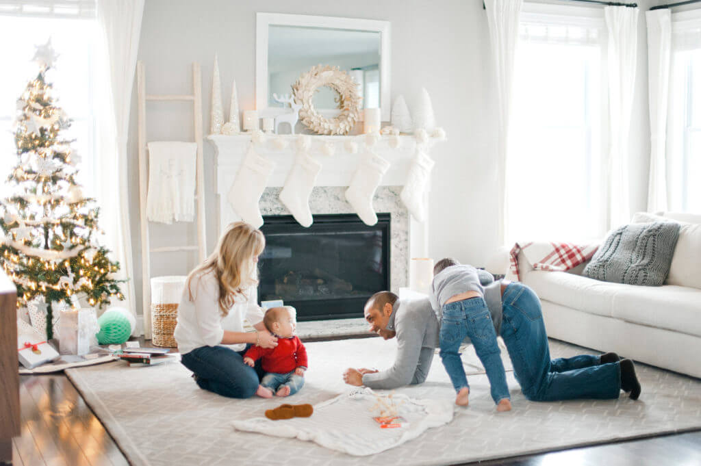 Holiday Sale at Tom Adams' - Family in Living Room during the Holidays