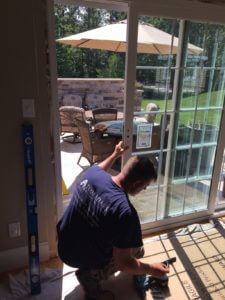 Tom Adams Installer fixing Patio Door